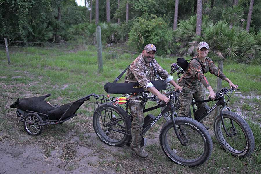 rambo bikes two hunters carrying kill