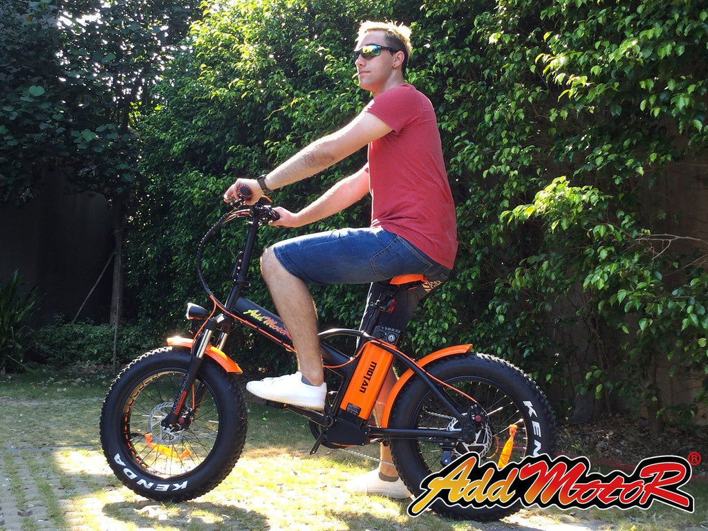 addmotor motan m-150 p7 fat tire folding ebike outside with guy riding