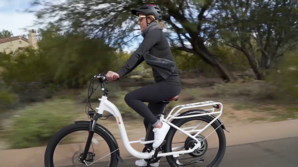 young lady riding the ewheels ew-step-thru ebike