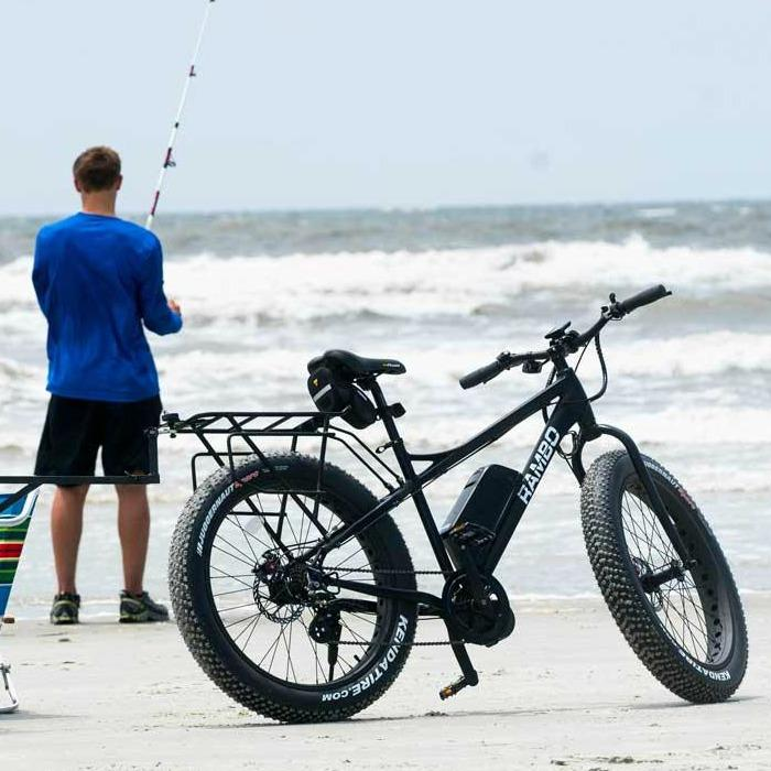 guy at beach fishing with fat tire electric bike