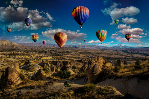 hot air balloons over mountain range