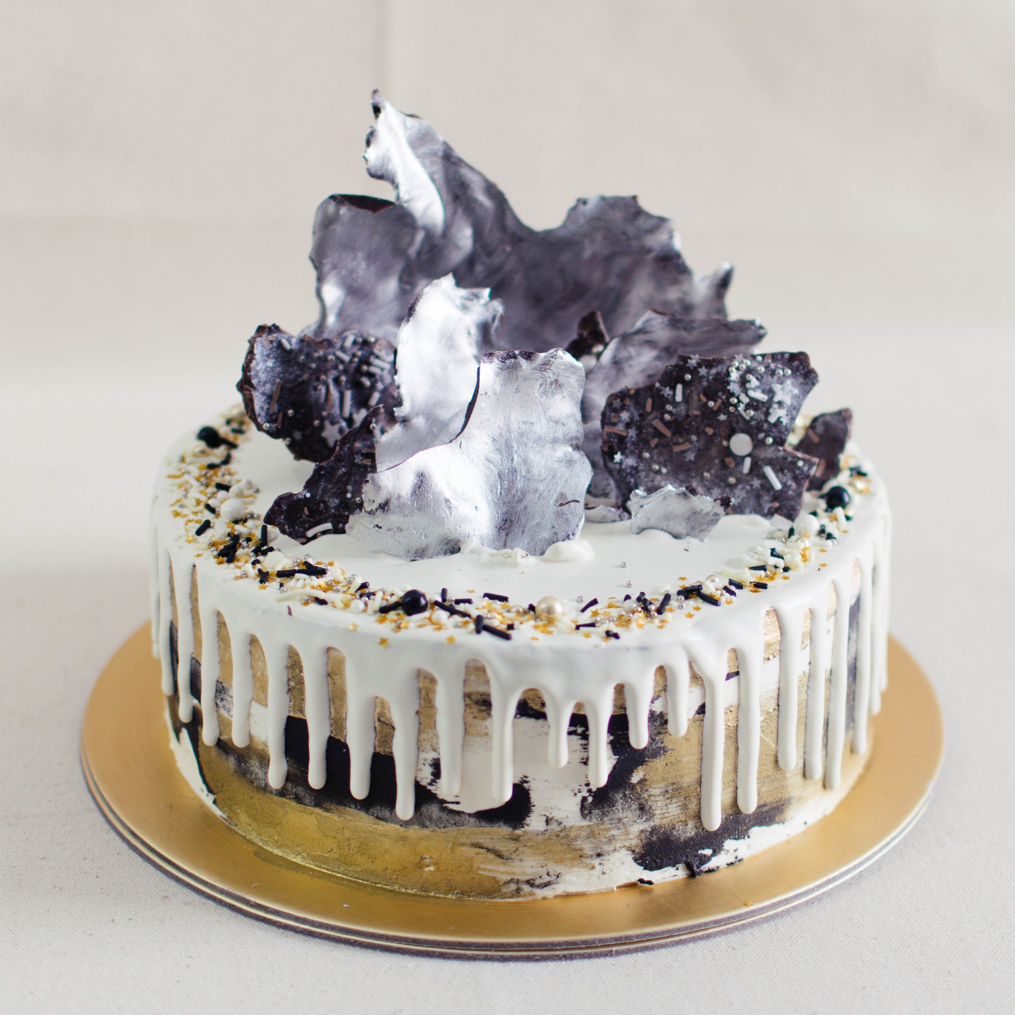 Black & Gold Marble with Silver Chocolate Sails - Custom Bakes by Edith Patisserie