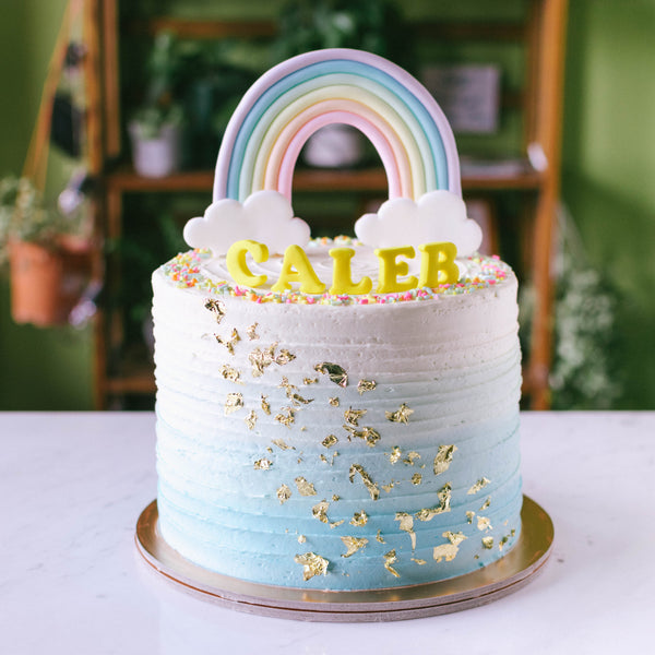 Ombre with Cascading Gold Leaves & Rainbow Topper - Custom Bakes by Edith Patisserie