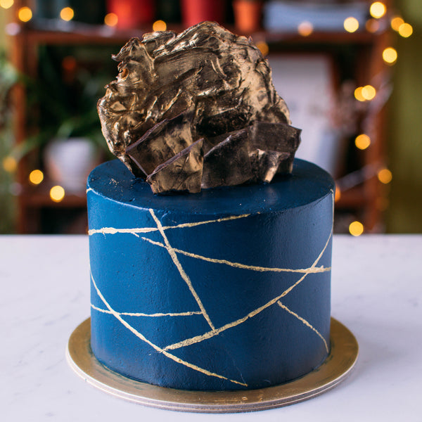 Solid Colour with Gold Line Accents and Chocolate Sails - Custom Bakes by Edith Patisserie