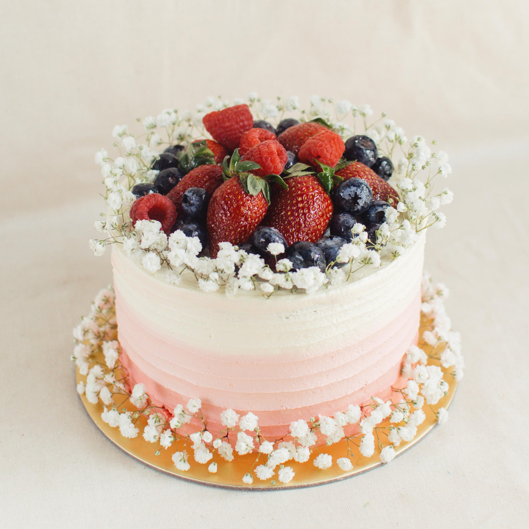 Ombre with Baby's Breath and Mixed Berries - Custom Bakes by Edith Patisserie