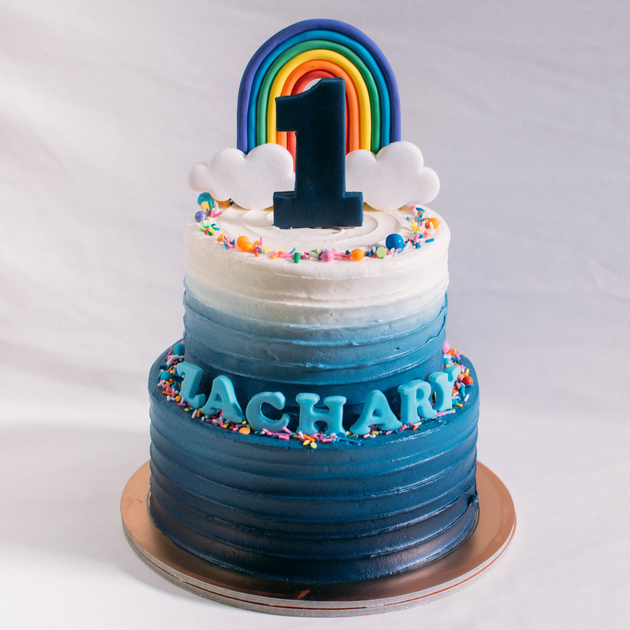Two-Tier Ombre with Rainbow Decor - Custom Bakes by Edith Patisserie