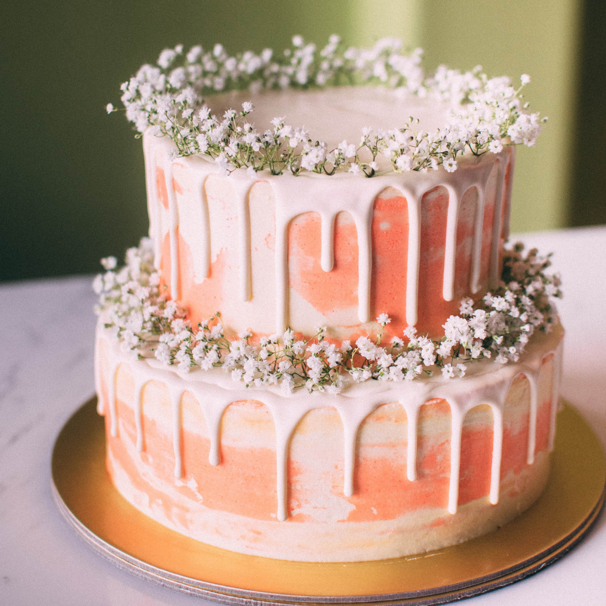 Two-Tier Marbled Drizzle Cake with Baby's Breath - Custom Bakes by Edith Patisserie