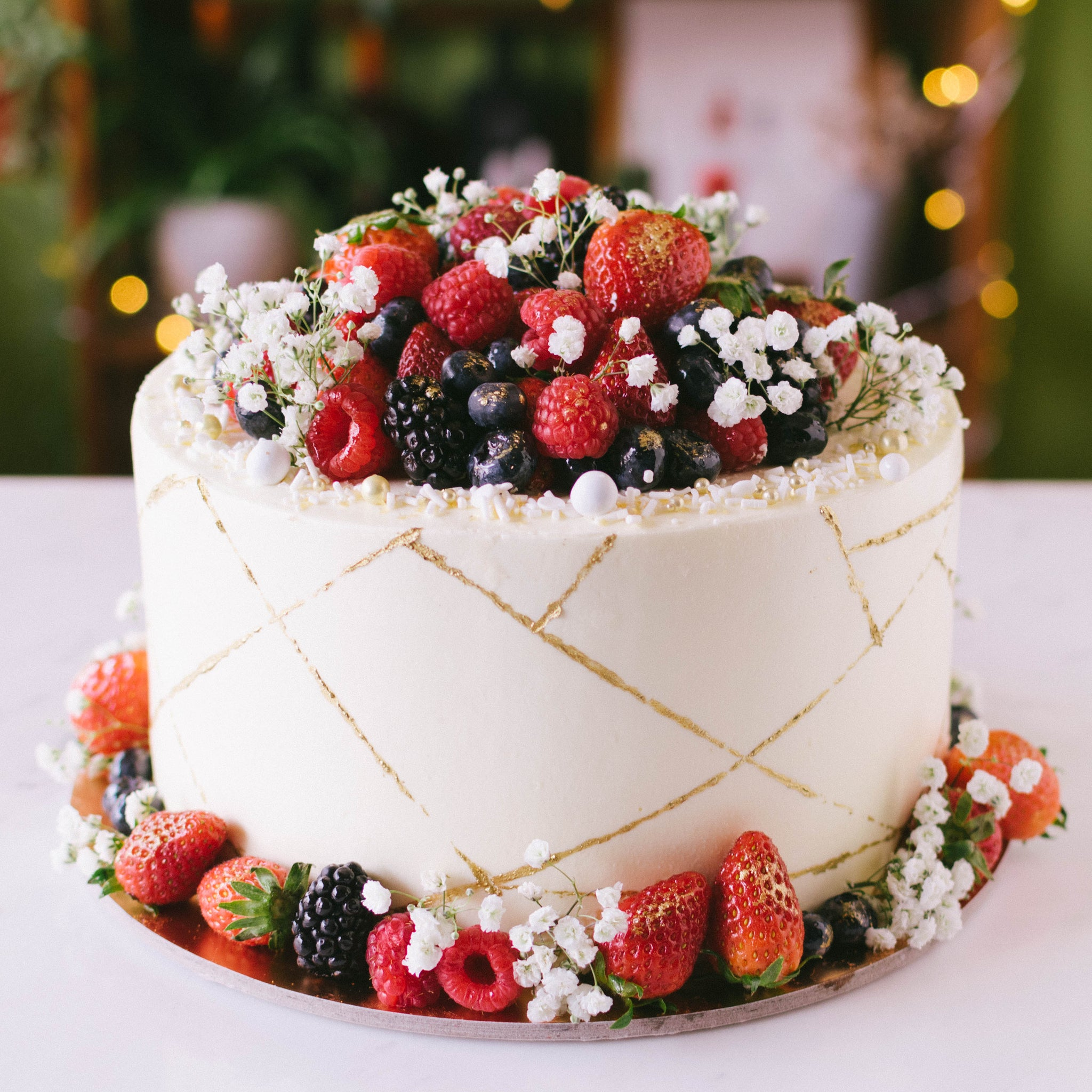 Gold Accent Cake with Mixed Berries and Florals - Custom Bakes by Edith Patisserie