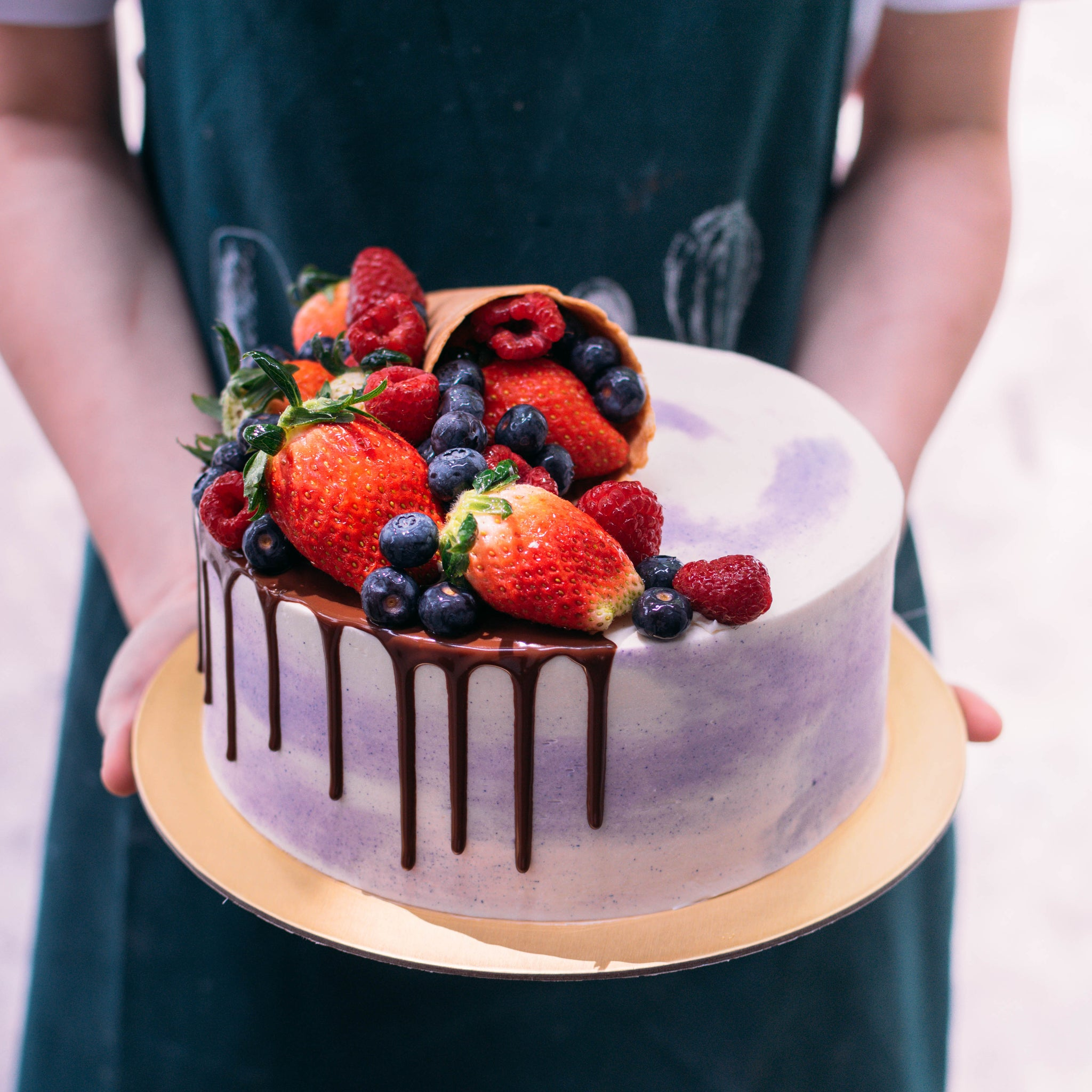 Marbled Cake with Drizzle and Cascading Berries - Custom Bakes by Edith Patisserie
