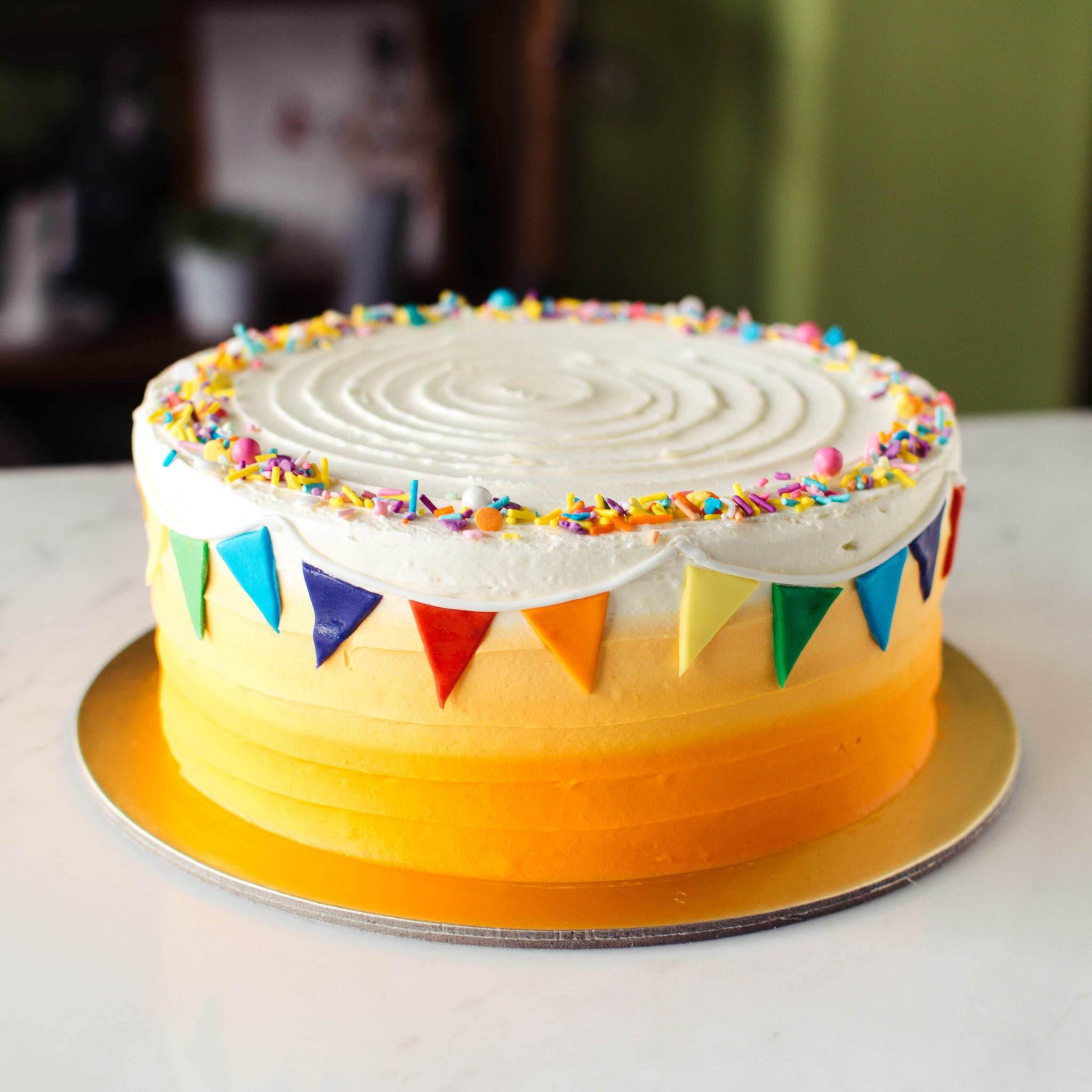 Ombre Striped with Rainbow Bunting - Custom Bakes by Edith Patisserie