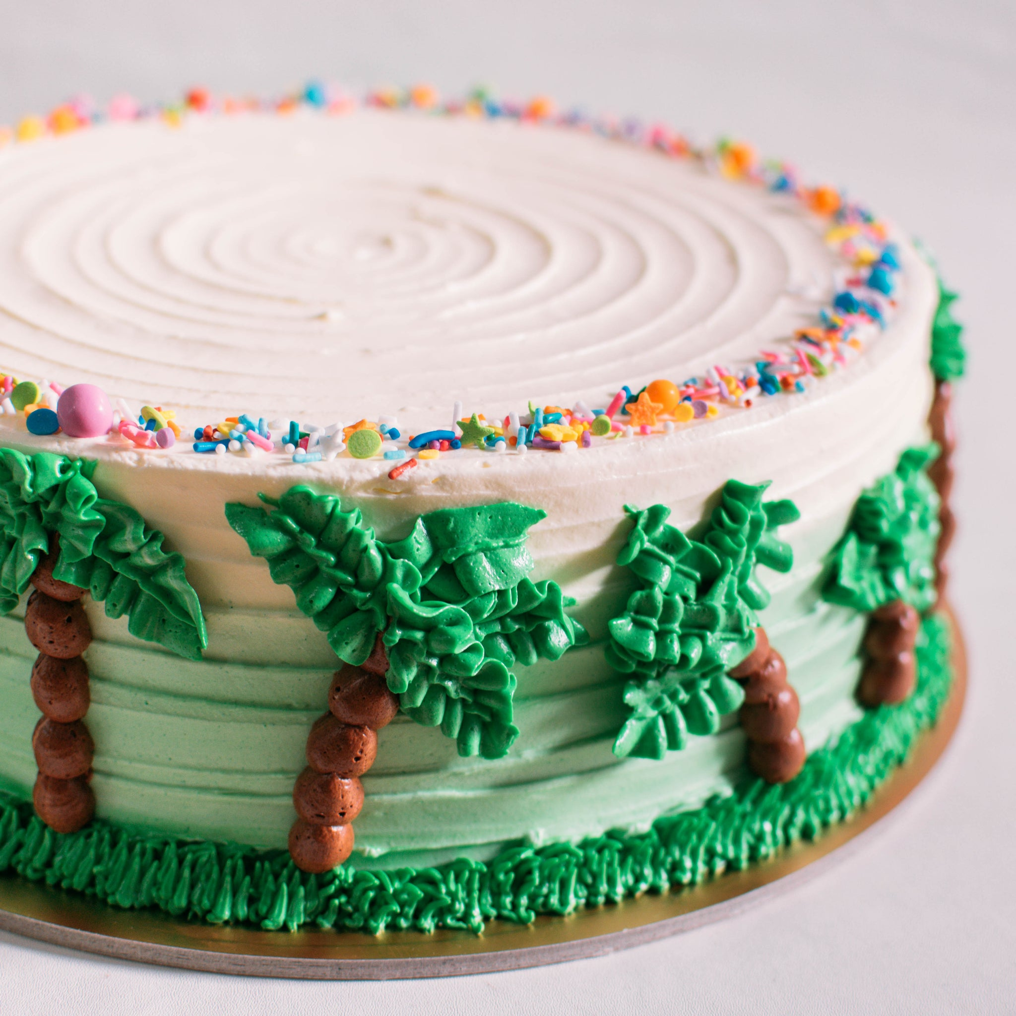 Pastel Green Ombre Cake with Piped Palm Trees - Custom Bakes by Edith Patisserie