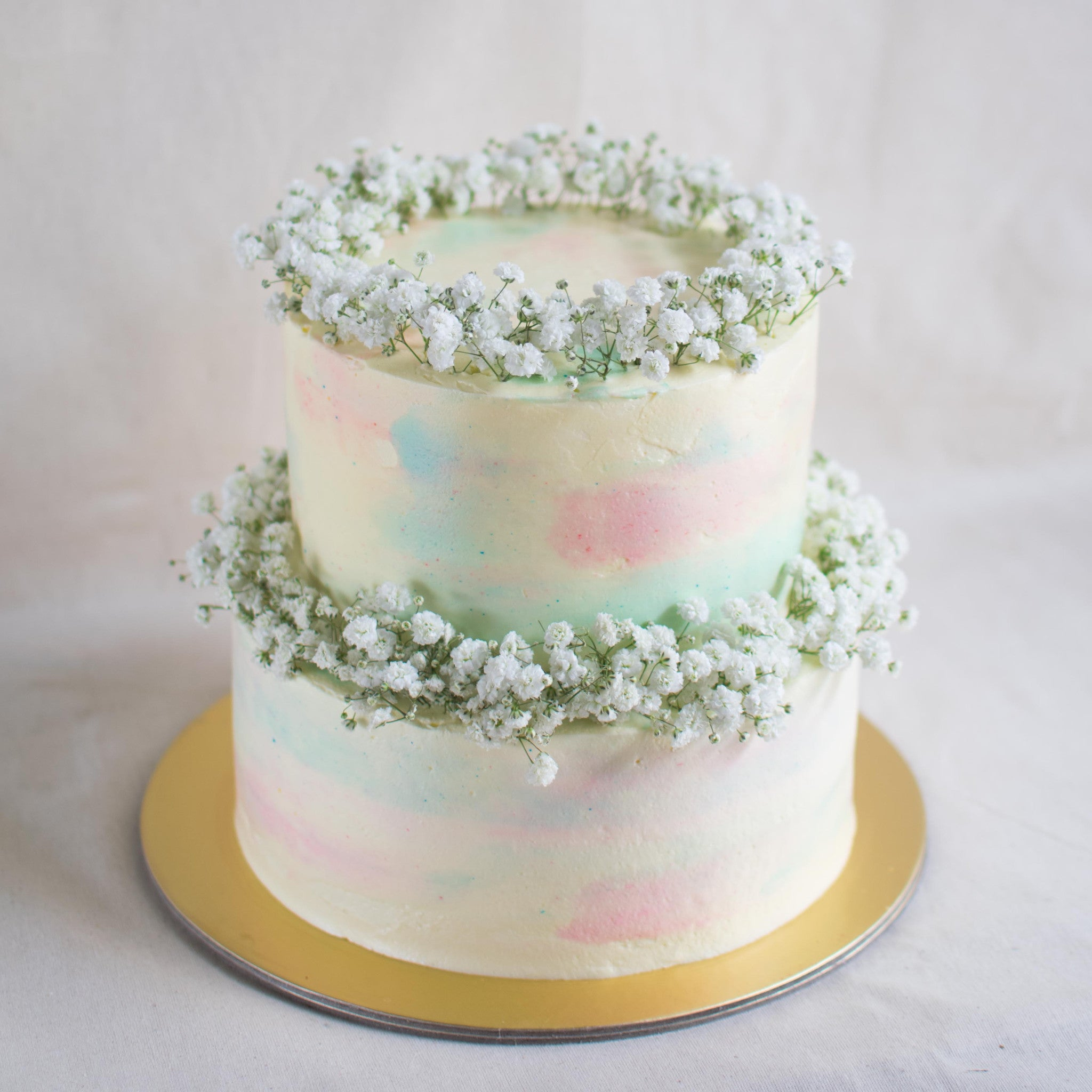 Two-Tier Pastel Marble with Baby's Breath - Custom Bakes by Edith Patisserie