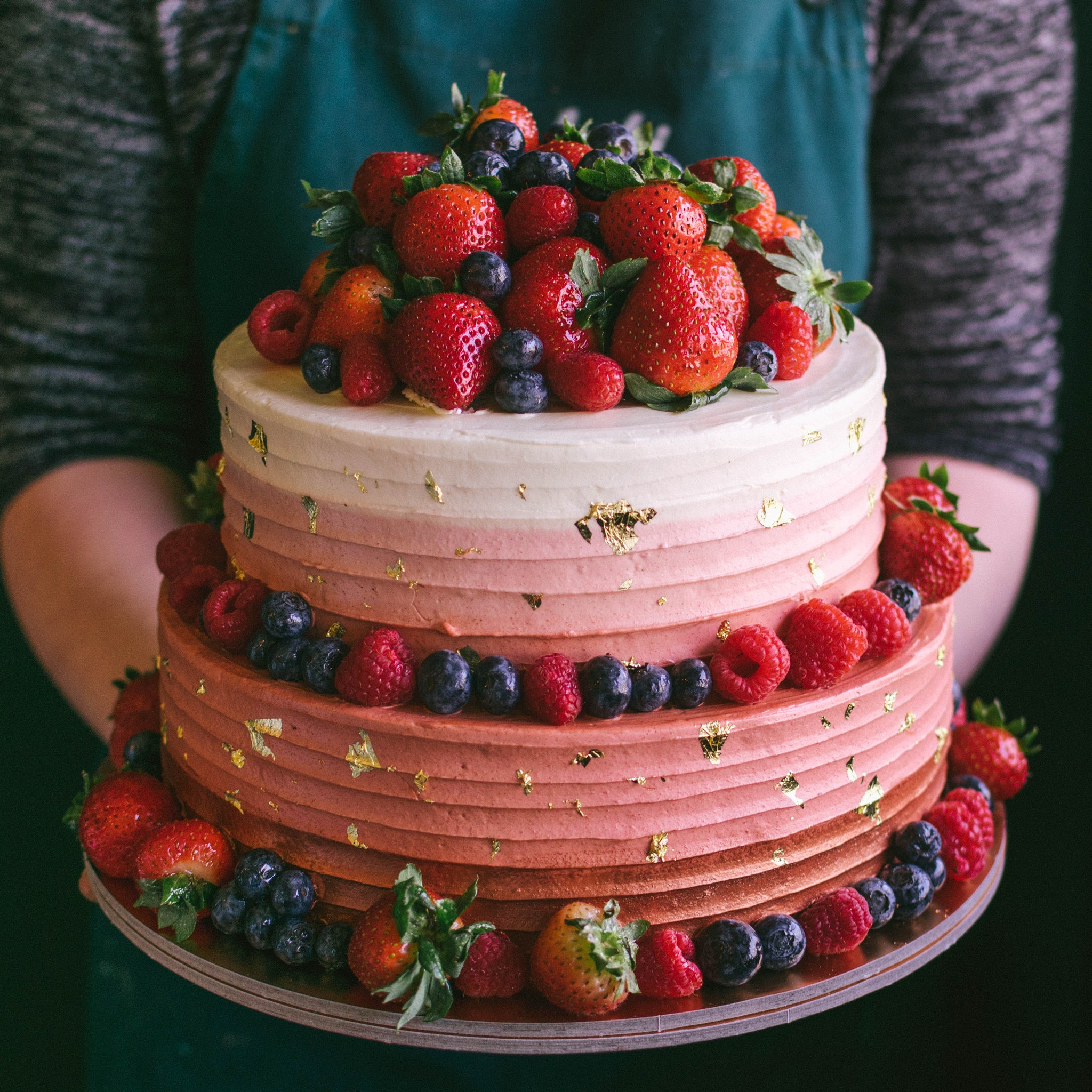 Two-tier Ombre striped with Gold Leaves and Mixed Berries - Custom Bakes by Edith Patisserie