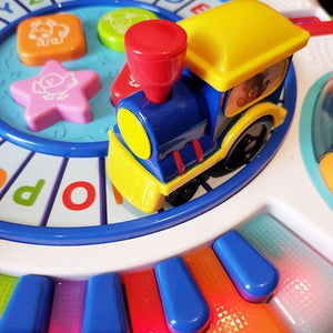 Letter Train and Piano Activity Table is great value with multiple ways for babies to play