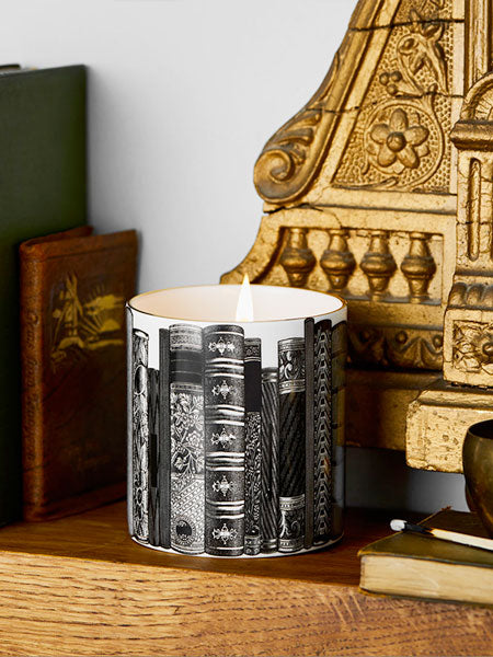THE LIBRARY  Evoking mahogany shelves full of leather bound books and reading under the flicker of warming candlelight.  Aromas of rich wood, amber, pink pepper and pomegranate.