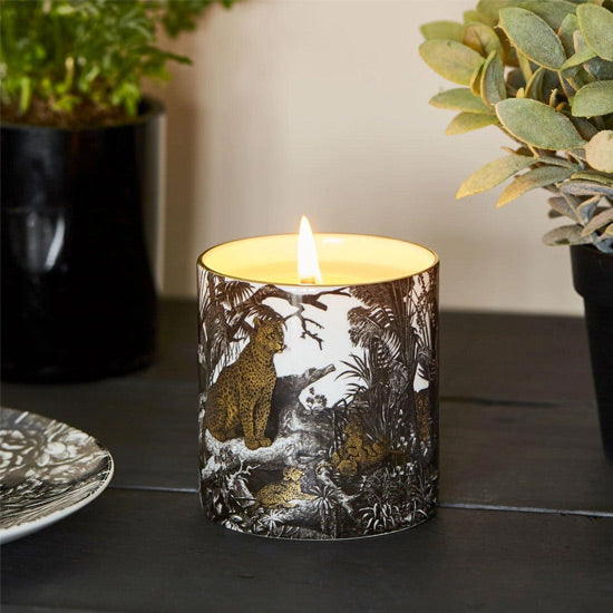 jungle scented candle on desk