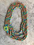 Necklace wooden beads and green heart