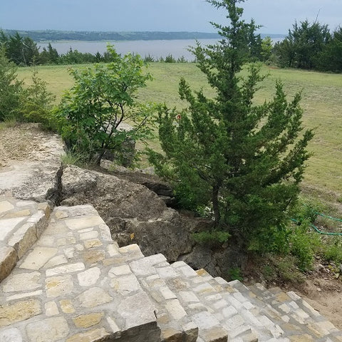 A view of the lake over the native limestone staircase to the Rose Quarry