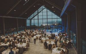Reception photo from large wedding in the Cedar Pavilion at Blue Vista. Photo Credit: Megan Thornton / Demiurge Photography