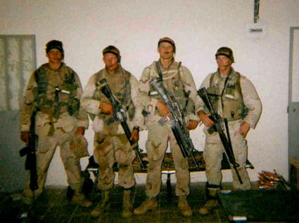Me (Second from Right) with team after Recon Patrol in Iraq 2003