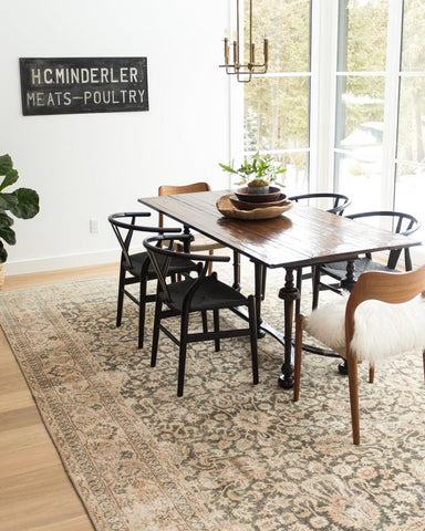 dining room with large Turkish rug and vintage decor