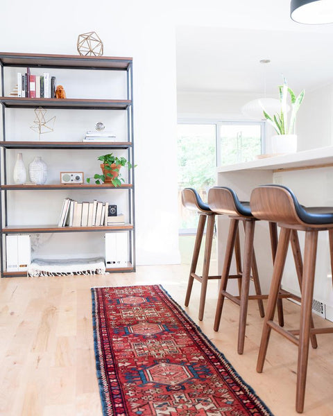 kitchen stools and shelving with persian rug