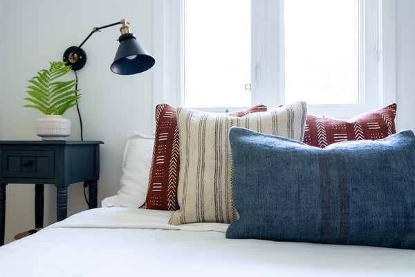 layered pillows on bed