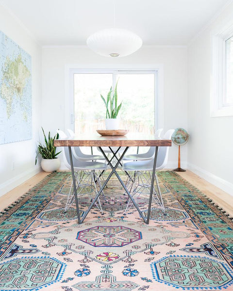 kitchen table with caucasian rug under