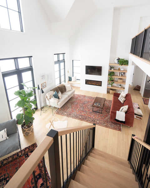picture of living room from above with high ceilings