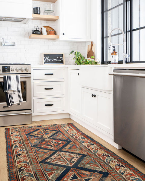 picture of a kitchen with vintage rug