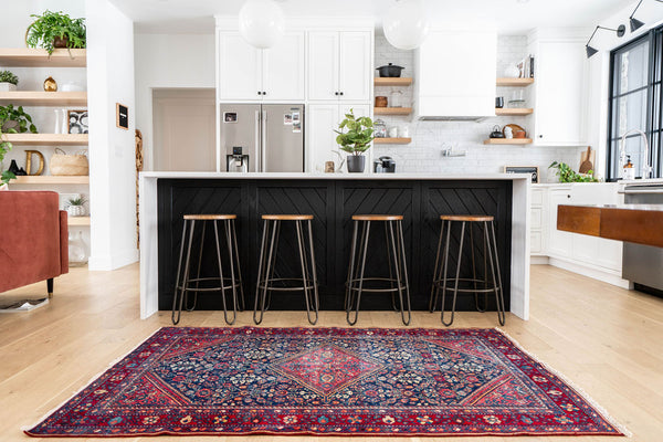 kitchen with bar stools and kitchen island