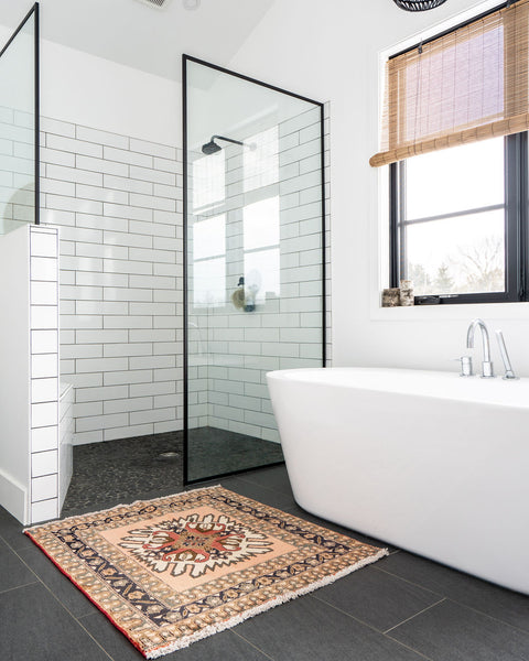 bathroom with soaker tub and stand up shower