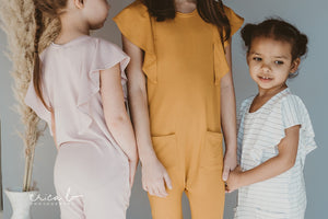 rose and doll's spring line featuring sustainable children's flutter sleeve romper  clothing made from bamboo