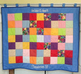 A quilt wall hanging for an organization