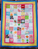 Quilt made from baby bibs, onesies, and some of mom's clothing