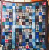 This quilt is made from work shirts, with an H made of denim work jeans in the middle