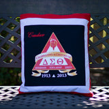 Quillow for the sorority Delta Sigma Theta, folded up as a pillow