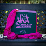 Quillow for the sorority Alpha Kappa Alpha, with some of the blanket pulled out, with name embroidery