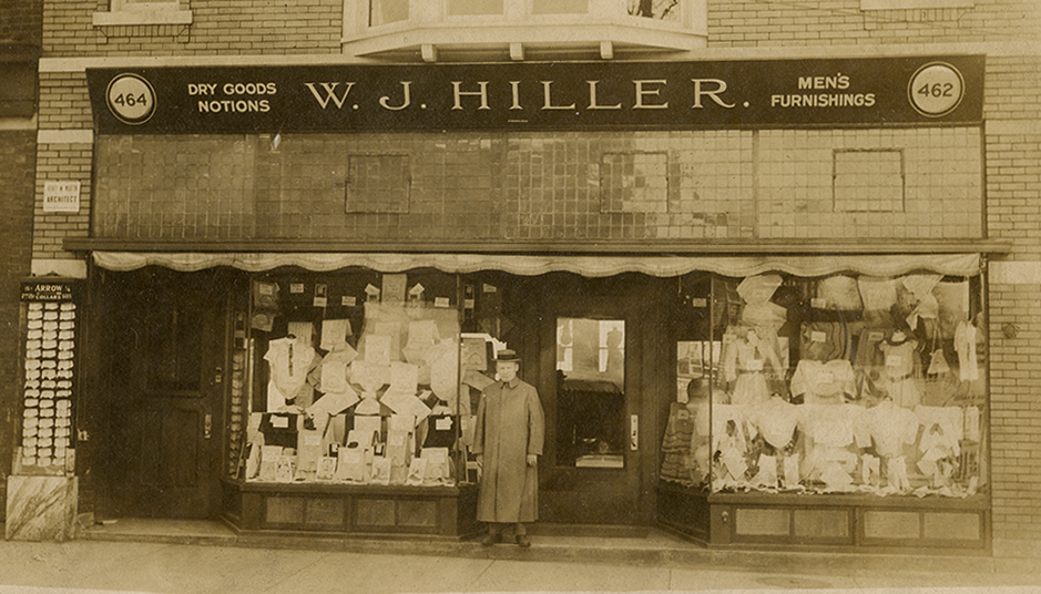 W.J. Hiller in front of his first store.