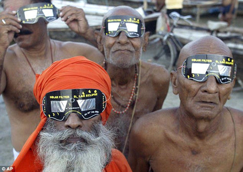 Indian holy men, aka Sadhus, wearing solar eclipse viewing glasses.
