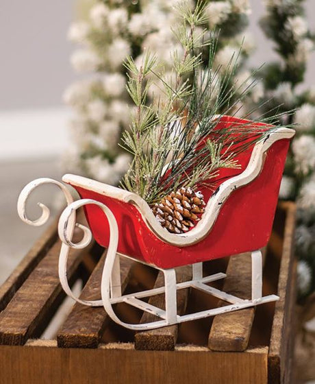 rustic red and white wooden sleigh