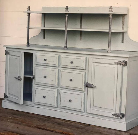 pale blue painted sideboard in creamery style with vintage hardware