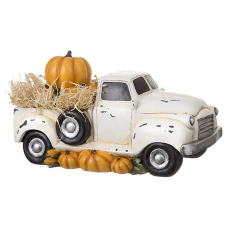 white truck with pumpkins in bed