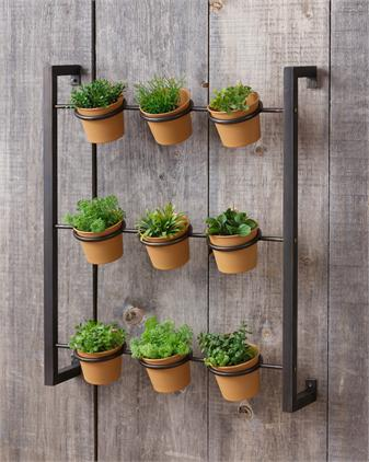 Metal wall-hung herb planter with nine terra cotta pots