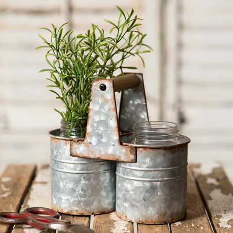 galvanized metal caddy with handle and two spaces for jars or cans