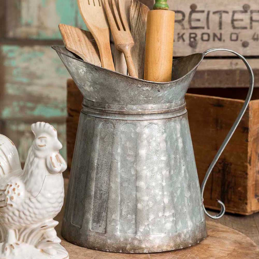 galvanized metal milk pitcher with wide ribbed side and wide lip. Rustic appearance.
