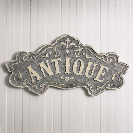 gray metal antique sign