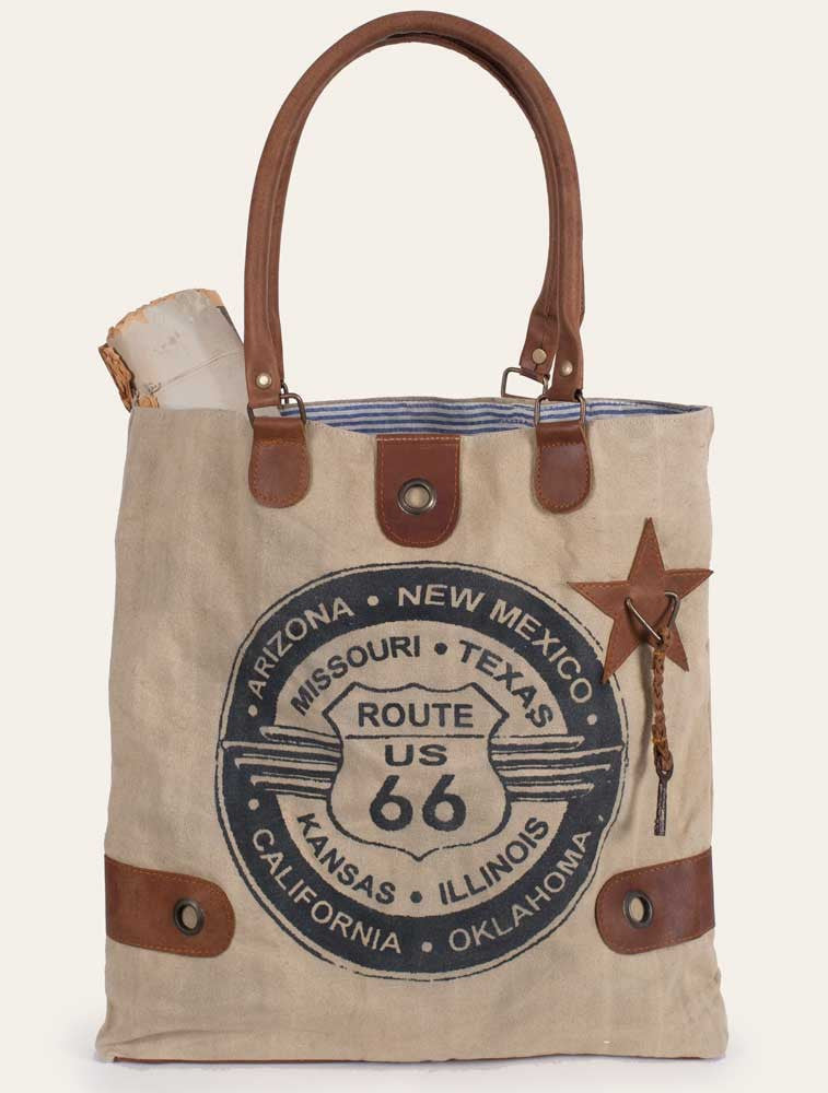 stonewashed canvas tote with leather accents and Route 66 emblem on one side