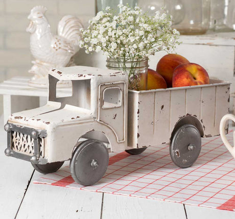 white metal truck with planter bed contained mason jar with flowers