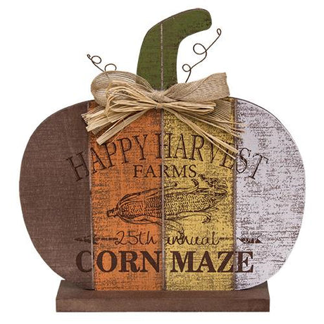 wooden pumpkin with Happy Harvest Corn Maze text